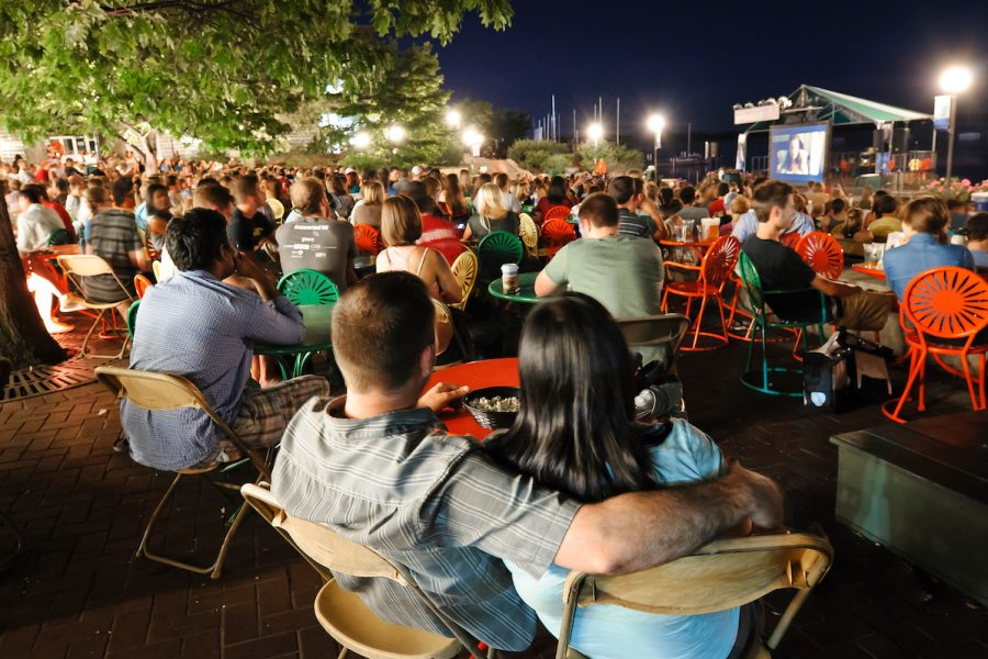 People watching a film on the Terrace at night