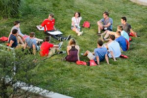 New-student leader Jack Lindenberg, left of center, talks with incoming first-year undergraduates